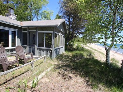Photo for Arrowhead Waterfront Log Cottage On Sand Beach With Fireplace.