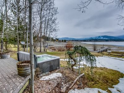 Photo for Lakefront true log home w/ private hot tub, dock & heated floors!
