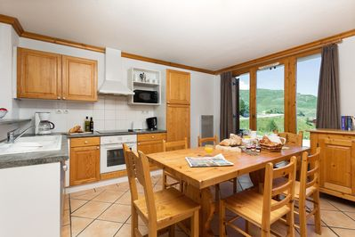 Enjoy the fully-equipped kitchen and grand dining table.