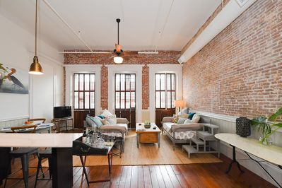 View of the loft with exposed brick walls