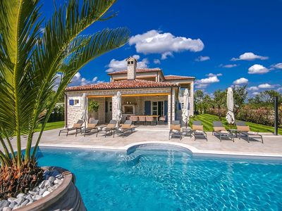 Photo for Luxurious detached villa with private pool, large garden, shared tennis court and playground