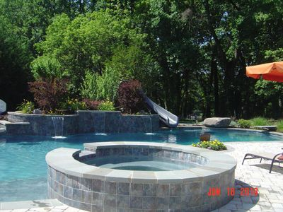 Pool with waterfalls, slide and 8+ person hot tub