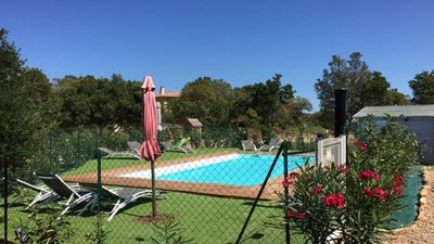 Photo for Semi-detached air-conditioned semi-detached villa in residence of 3 villas with heated swimming pool