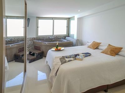 Photo for Modern apartment with Jacuzzi on the beach