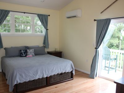 master bedroom with king size sleep number bed hi def tv a