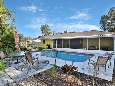 Photo for Dog-friendly, renovated home w/ outdoor pool, patio and screened lanai
