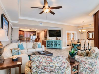 Photo for *New Rental*Beautifully decorated, beach front,  lazy river, garage level!