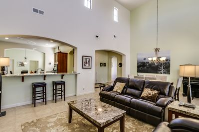 This is living room to kitchen and entry way