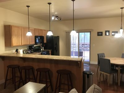 Breakfast bar and large kitchen with dining table Patio view