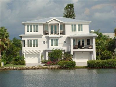 Luxurious executive home with bay view in front and deep water canal behind