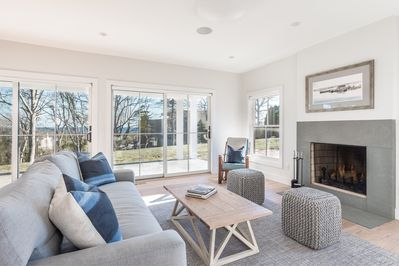 Open living room with fireplace and easy access to the patio