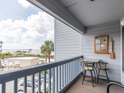Photo for Bay and Pool Views from your Balcony! Gated Community with Beach Access, Pool and Tennis