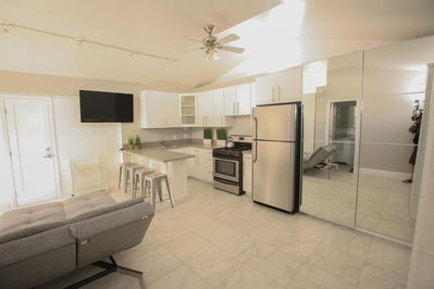 Modern Kitchen with gas stove, culinary cooking conveniences and storage space.