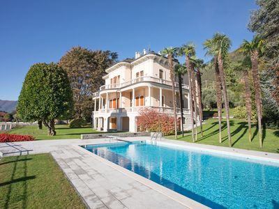 Photo for Beautiful home set in period villa located directly on the lake with pool