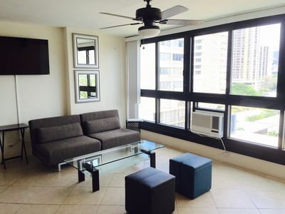 Large living room with 55 Inch smart TV you can watch Netflix on with city view!
