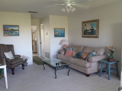 Photo for Steps to Atlantic ocean, heated pool and clubhouse. Charming low-key town.
