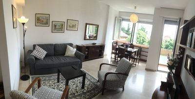 Living room with sofa bed and the view on the garden