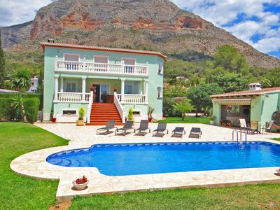 Photo for Villa with large garden and pool area. wifi & aircon.