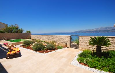 Photo for Exclusive Villa with pool at seafront