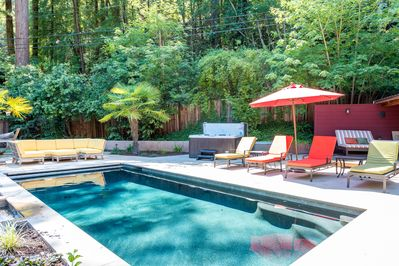Poolside, including the hot tub, outdoor sectional & hammock