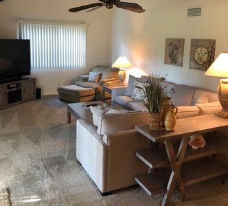 Living Room - large tv, sleeper sectional, vaulted ceilings