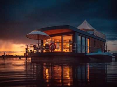 Photo for floating holiday home - close to nature and luxurious on an idyllic lake