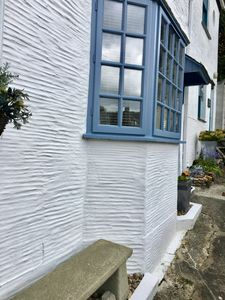 Front of Seahorse Cottage with lovely stone seat outside . A wonderful suntrap.