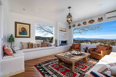 The living space is designed in a traditional New Mexico style with modern details and beautiful art pieces. Panoramic picture windows let in lots of natural light and offer stunning views of the surrounding mountains and mesas.