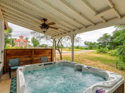 Photo for Romance by the river with a shared hot tub & firepit - right in town!