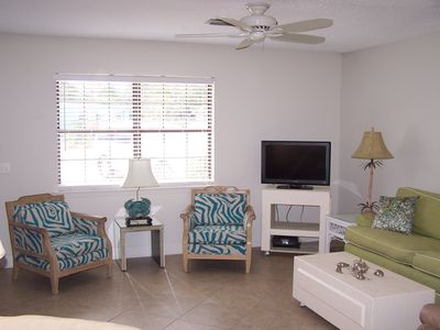 View of the Den,with our Aqua Zebra Chairs and Lime Sofa ,2 Recliners not shown