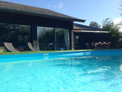 Photo for Superb 160m² wooden house with private heated pool in Perros-Guirec
