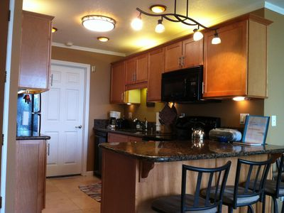 Photo for Pristine Condo with WIFI, Parking Garage & Elevator-Steps to the Beach