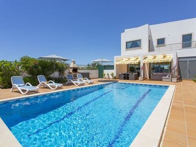 Photo for Modern, high quality villa, heated pool, walk to restaurants and beaches