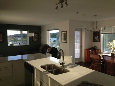 bright sunny living room, dining room and view from kitchen counter