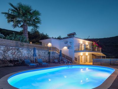 Photo for This 2-bedroom villa for up to 5 guests is located in Keri and has a private swimming pool, air-cond