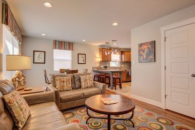 Bright open living room with quick access to dining room and kitchen.