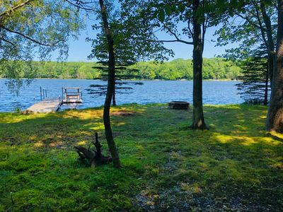 Photo for Lakefront Paradise! Private lakefront with Dock. Walk to Beach. Sunsets!