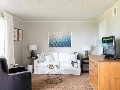 Photo for Sunset views in this coastal modern condo overlooking Mobile Bay!