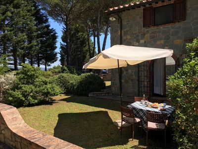 private garden with dining table and chairs