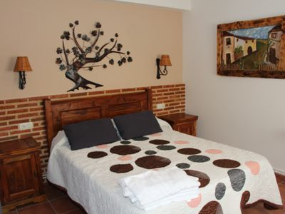 Photo for Beautiful apartment with fireplace and hydromassage shower: La Pesquera