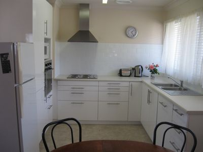 New kitchen with dishwasher, cooktop, microwave and oven