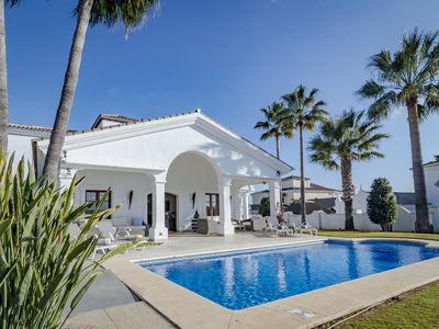 Photo for Luxury Villa with stunning views of mountain and sea to the south west with heated pool