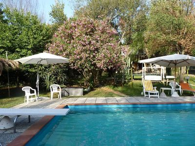 Photo for Nice apartment with beautiful garden and swimming pool, only 10min. by the sea
