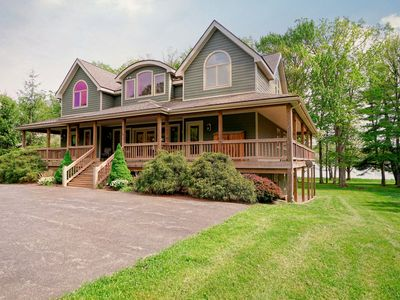 Lakefront home w/ large wraparound deck, hot tub, basketball hoop & fire pit!
