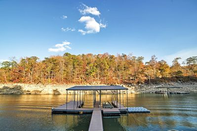 The property's location offers privacy and elegance among a scenic wooded area.
