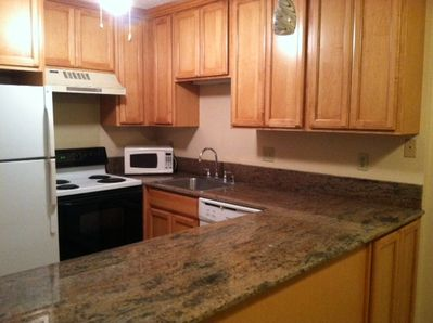 New kitchen cabinets with granite counter tops.