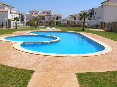 Photo for Two bedroom townhouse with large terrace facing the pool
