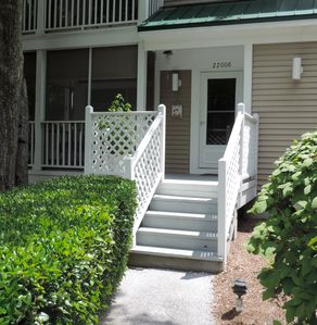Front entrance with view of lovely carpeted screened in porch