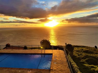 Photo for Secluded Sunset Villa set in lush mature gardens with amazing sea view