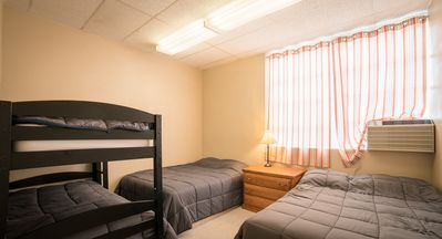 Bedroom 3 with 2 queen beds and twin bunk beds